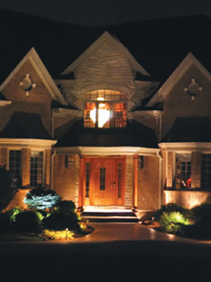 Isn't this a welcoming site to come home to? Landscape lighting is easy to install and makes your home safer and more welcoming.