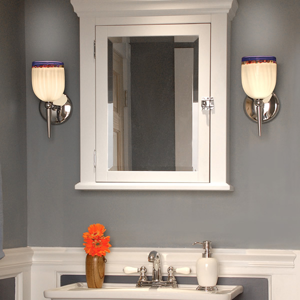 The Rosetta Wall Sconce from WAC Lighting's European Collection on either side of a mirrored medicine cabinet. Bella figura, Rosetta offers fine Italian styles that combines a classic profile with multiple murine glass patterns that will enhance any setting with a perfect mix of form and function.