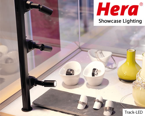 "HERA Track-LED Showcase Lighting This product is great for any display case, especially those with glass shelving. You mount the ""track"" vertically, then attach individual spotlights. The spotlights swivel to direct the light exactly where you want."