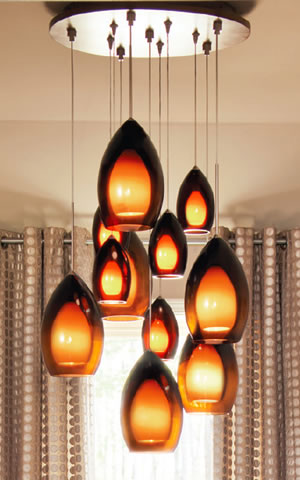 Line-Low 11-port canopy with Low Voltage Fire Pendants and Line Voltage Fire Grande Pendants