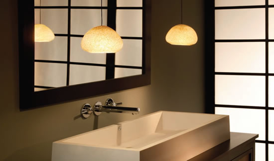 "River Rock Wedge Pebble Brown Pendants on Free Jack 4"" Round Flush Canopies in Antique Bronze suspended to each side of the sink in a contemporary bath"