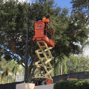 Man on cherry picker converting street lighting to LED
