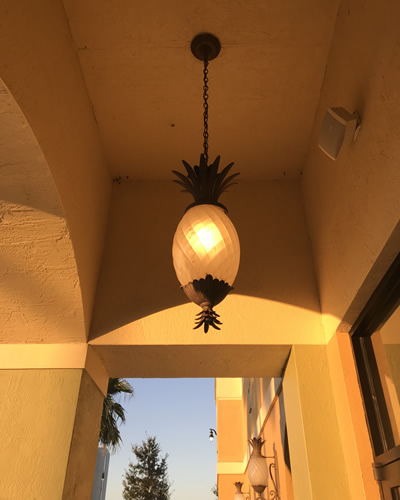 "The hanging lantern is 12.5"" wide, 28.5"" tall - Pineapple Lighting at Pollo Tropical – myDesign42"