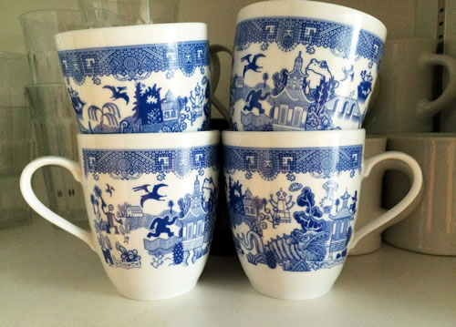 CalamityWare Mugs have giant fish, pterodactyls, a 4-armed robot, flying saucers, the sasquatch, giant frogs and probably more. - CalamityWare: Fun Twist on Blue Willow – myDesign42