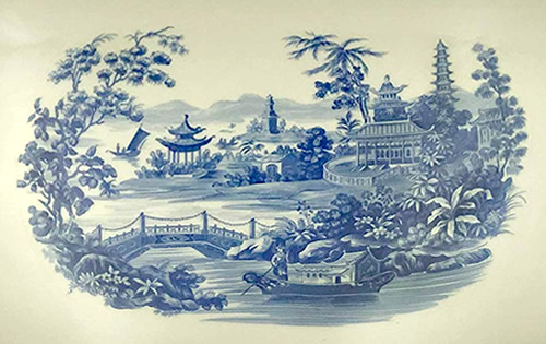 The motif in the center of the Pagoda Blue and Tea Service Tray