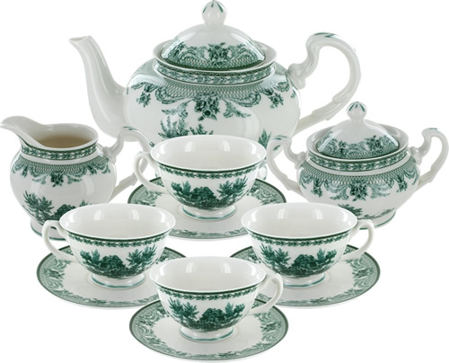 Green Toile Tea Set includes four cups, four saucers, a sugarbowl with lid, cream pitcher and teapot with lid.