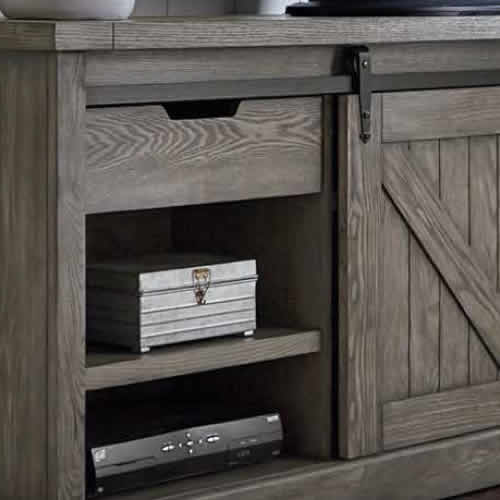 Detail of the steel rails for the sliding barn style door on the credenza and console