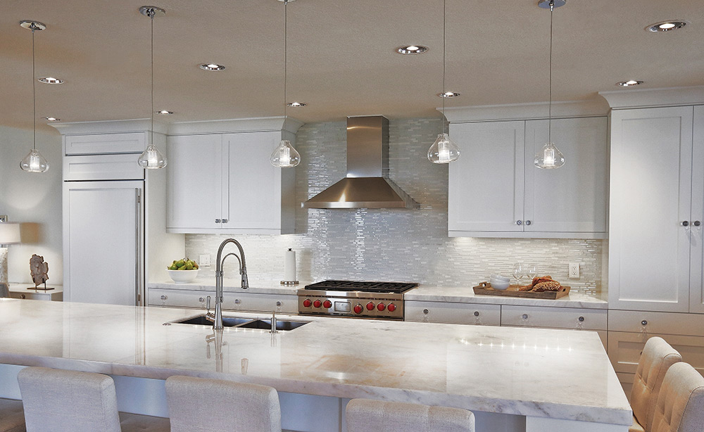 White Contemporary Kitchen with Tech Lighting Cheers Pendants, Undercabinet Lighting and Recessed Lighting