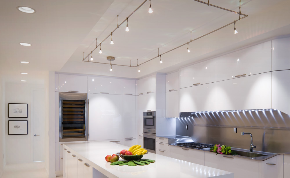 High Gloss White Modern Kitchen with Tech Lighting Monorail, Undercabinet Lighting and Recessed Lighting
