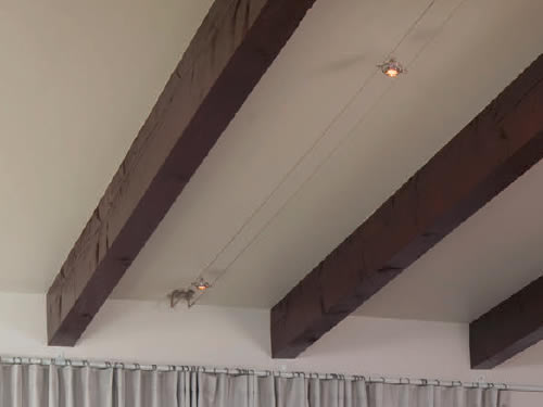 Tech Lighting Kable with K-Hello Lights Cable Lighting on a ceiling with exposed beams