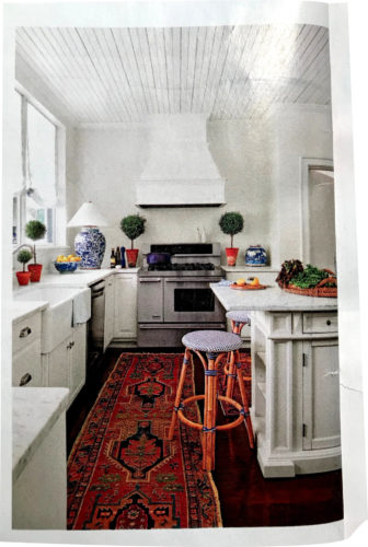 Even the kitchen uses a blue and white lamp, a large ginger jar on the counter - Southern Living January 2018, article by Elizabeth Passarella with photographs by Hector Manuel Sanchez.