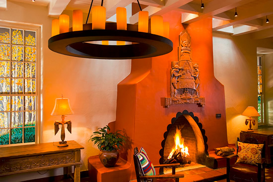 La Fonda on the Plaza in Sante Fe, NM The fireplace, designed by Arnold Rönnebeck, is inspired by traditional beehive shaped fireplaces built into the adobe walls. Photo by Atakra - Southwestern Architecture and Décor – myDesign42