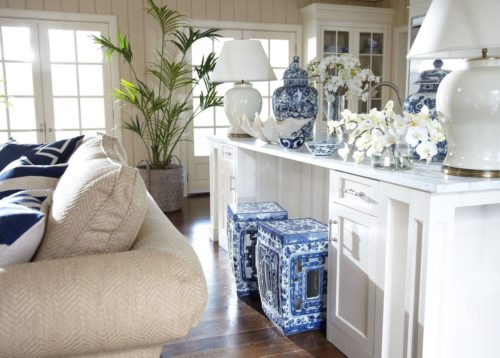 Traditional room with two Ethan Allen Pierced Garden Seats used as accent furniture