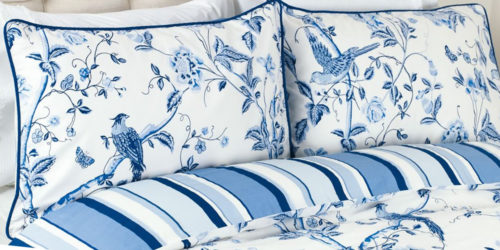 Laura Ashley Summer Palace has birds and flowers in royal blue against a white background.