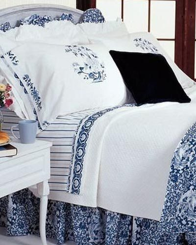 Ralph Lauren Oriental Influenced Bedding - Comforter, dust ruffle and ruffled pillow shams in Ralph Lauren Tamarind Blue with Jonquil Striped Sheets, White pillow cases and Medallion Pattern pillow cases - Ralph Lauren Chinese Pattern in Blue and White with stylized flowers, leaves and Chinese dragons or sea serpents - Ralph Lauren Chinoiserie