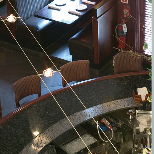 Looking down on K-Hello cable lights. This installation is in a restaurant. - DIY Guide to Buying and Designing Cable Light – My Design42