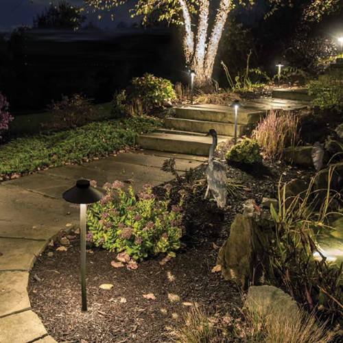 The sleek linear design of WAC Lighting TIKI Path Light works well to light pathways or flower beds.