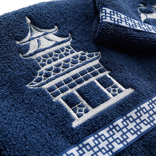 Vern Yip Chinoiserie Bath Towel has a pagoda in white embroidery and a decorative grosgrain ribbon trim