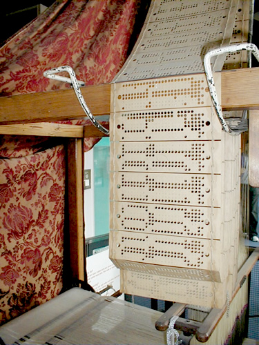 Punch Cards running through Jacquard Loom Museum of Science and Industry Manchester, England Photo by George Online