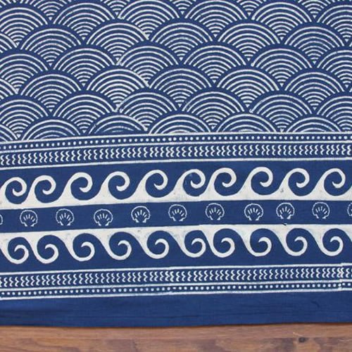 Saffron Marigold Pacific Blue: Ivory waves patterned rhythmically across a deep navy / indigo blue ground.