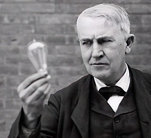 Edison holding a light bulb