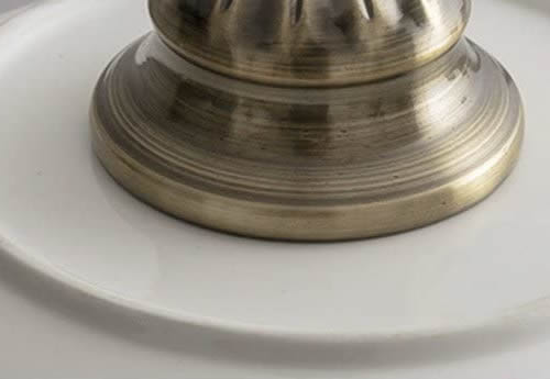 The pendant looks like a real bowl has a hold drilled in it to fit an antique brass socket set.