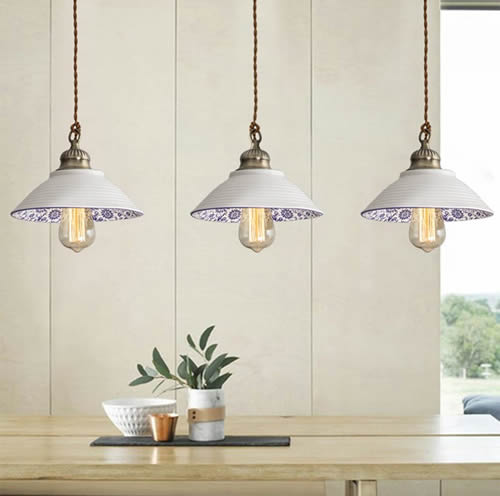 Three Farmhouse Blue and White Porcelain Bowl Pendants over a long table