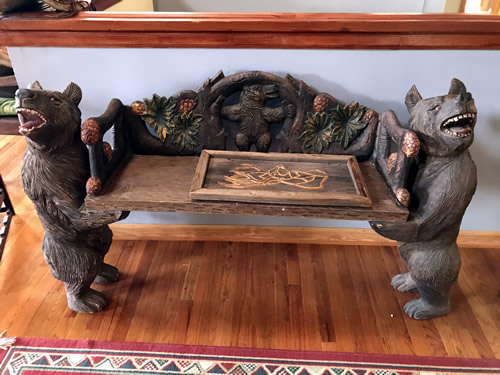 Bench with carved bears and branches at the Auction Preview at Indian Cave Lodge