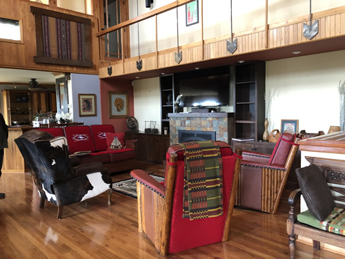 The living room furniture has red wool Chimayo weavings on the cushions