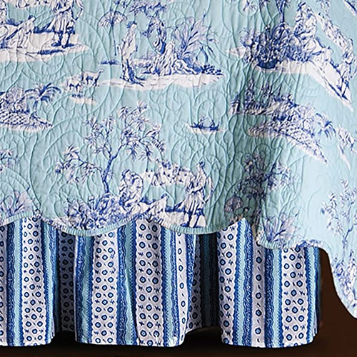 Colonial Williamsburg Hampstead Chinoiserie Toile quilt with coordinating bed skirt in cobalt blue and white stripes with tiny flowers and lace pattern