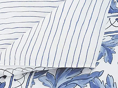 Molly Hatch Blue Bird Bedding has white with blue crayon stripes on the other side.