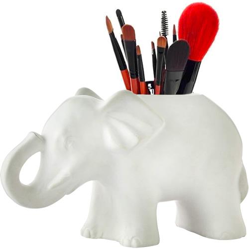 Vern Yip Shangri La Elephant holds makeup brushes