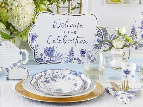"""Kate Aspen Blue Willow Paper Plates and napkin, Place Card, Welcome to the Celebration Sign, Blue Willow framed Wedding Guest Book Alternative, votive tea light holder in frosted glass with Blue Willow motifs and an """"Advice for the Bride"""" Blue Willow Teapot Wedding Advice Card"""