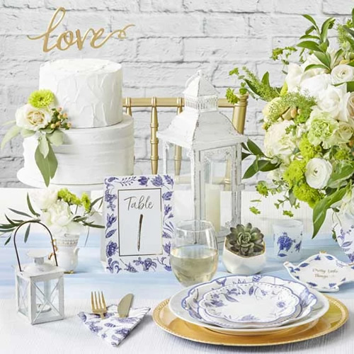 Kate Aspen Blue Willow Wedding Table Number, Paper Plates and napkin, Blue Willow Teapot Pretty Little Things Trinket Dish and a votive tea light holder in frosted glass with Blue Willow motifs
