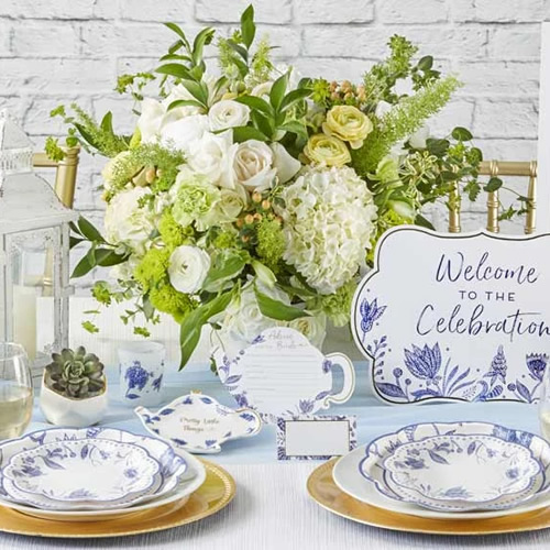 Kate Aspen Blue Willow Paper Plates, Welcome to the Celebration Sign, Blue Willow Teapot Pretty Little Things Trinket Dish and Wedding Advice Cards and a votive tea light holder in frosted glass with Blue Willow motifs