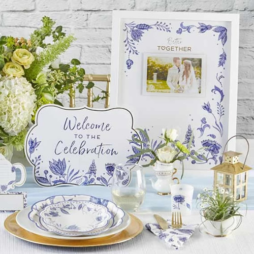 Kate Aspen Blue Willow Paper Plates and napkin, Place Card, Welcome to the Celebration Sign, Blue Willow framed Wedding Guest Book Alternative and a votive tea light holder in frosted glass with Blue Willow motifs